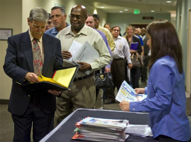 Job seekers enter an employment fair in San Antonio, Texas. Financial sector lay-offs are up 37pc in the first quarter compared to a year ago despite benign banking conditions. Bloomberg