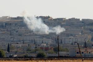 Smoke rises from the Syrian town of Kobani, as seen from the Turkish-Syrian border near the southeastern town of Suruc in Sanliurfa province. Reuters