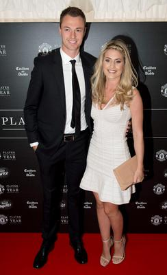 Manchester United's Northern Irish defender Jonny Evans and his wife Helen pose for pictures on the red carpet as they arrive to attend the 'Manchester United Player of the Year Awards' at Old Trafford stadium in Manchester, northern England, on May 19, 2015. AFP PHOTO / OLI SCARFFOLI SCARFF/AFP/Getty Images