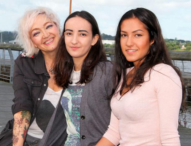 Tatiana Prochukhan with her daughters Nadia (centre) and Maria at home in New Ross after they got the good news
