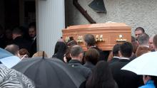 The coffin being carried into church. Funeral of Stephen (Steve) Harris, Divine Mercy Church, Balgaddy, Dublin. Picture: Caroline Quinn