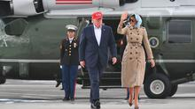 Trump and wife Melania head for Air Force One to depart Shannon. Photo: PA (Photo by MANDEL NGAN / AFP)