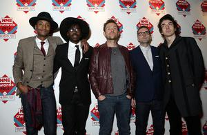 Damon Albarn (centre) arriving for the 2014 NME Awards, at Brixton Academy, London. PRESS ASSOCIATION Photo. Picture date: Wednesday February 26, 2014. Photo credit should read: Yui Mok/PA Wire