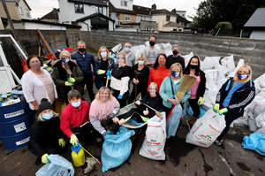 Joan and her team with some of the hundreds of bags of rubbish and rubble they filled in their efforts to breathe new life into the old boxing club premises in Ballybough. Photo: Steve Humphreys