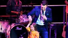 Nathan Carter dances with a young fan on stage during the Flood Aid Inishowen Concert. Photo: Margaret McLaughlin
