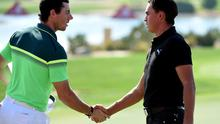Rory McIlroy of Northern Ireland and Rickie Fowler of the USA shake hands after their opening round during the first round of the Abu Dhabi HSBC Golf Championship at the Abu Dhabi Golf Club