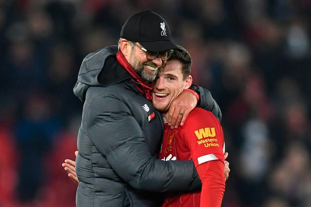 Liverpool manager Jurgen Klopp embraces Andy Robertson after his team's victory against Sheffield United. Photo: AFP via Getty Images