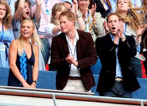 Their Royal Highnesses Prince William (R) and Prince Harry (C) and guest Chelsy Davy (L) watch the Concert for Diana at Wembley Stadium on July 1, 2007