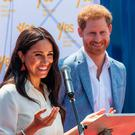 Meghan, Duchess of Sussex(L), is watched by Britain's Prince Harry, Duke of Sussex(R) as she delivers a speech at the Youth Employment Services Hub in Tembisa township, Johannesburg, on October 2, 2019