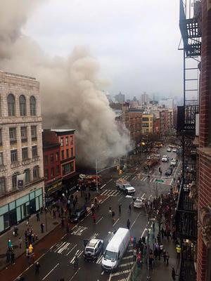 Smoke pours from a building after it collapsed in New York City's East Village as seen in this picture taken by Scott Westerfeld. Reuters/Scott Westerfeld