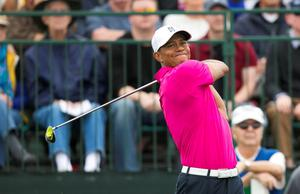 PGA golfer Tiger Woods hits his tee shot on the first hole to start his first round of the Waste Management Phoenix Open at TPC Scottsdale. Credit: David Wallace-Arizona Republic via USA TODAY Sports