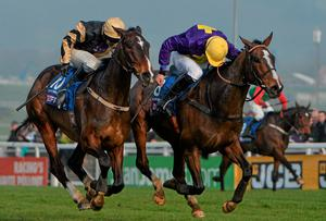 On His Own (left) and Lord Windermere - here fighting out the finish of last year's Cheltenham Gold Cup - renew their rivalry in tomorrow's Hennessy Cognac Gold Cup