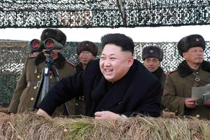 North Korean leader Kim Jong Un laughs as he watch a winter river-crossing attack drill of the armored infantry sub-units of the motorized strike group in the western sector of the front of the Korean People's Army