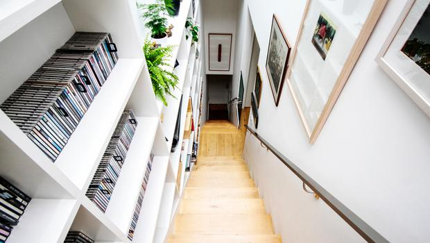 Alec Darragh's aluminum clad North Dublin terrace: The home is inviting, encouraging visitors to climb up a bright, light-filled wooden staircase lined with books shelves.