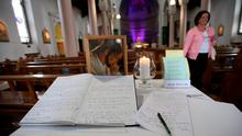 Books of condolence for the victims of the Berkeley balcony collapse are opened at Our Lady of Perpetual Succour church in Foxrock, Dublin. Niall Carson/PA Wire