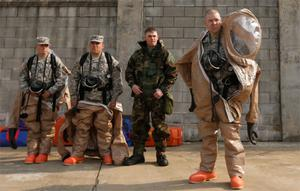 Soldiers of the US Army 23rd chemical battalion put on their gear