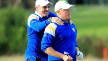 Europe's captain Paul McGinley congratulates Jamie Donaldson on the 15th hole shortly before sealing the Ryder Cup victory after Donaldson defeated Keegan Bradley