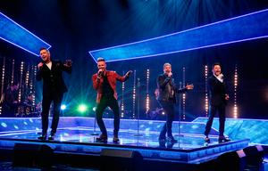 Westlife, (left to right) Markus Feehily, Nicky Byrne, Kian Egan and Shane Filan) during the filming for the Graham Norton Show