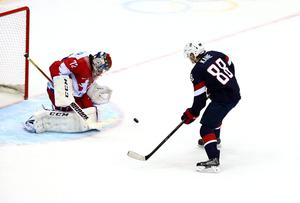 Patrick Kane #88 of the United States attempts a shot on goal against Sergei Bobrovski #72 of Russia on day 8 of the Sochi 2014 Winter Olympics