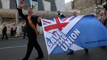 """An Orangemen march through the streets of Edinburgh during a """"Proud to be British"""" rally in Edinburgh in support of the Union, less than a week before Scotland votes on the Scottish Referendum. Andrew Milligan/PA Wire"""