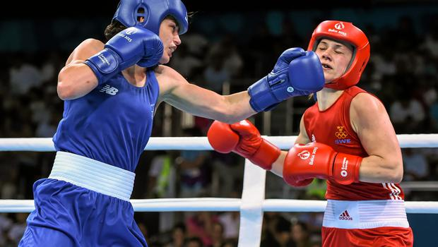 24 June 2015; Katie Taylor, Ireland, left, exchanges punches with Ida Lundblad, Sweden, during their Women's Boxing Light 60kg Quarter Final bout. 2015 European Games, Crystal Hall, Baku, Azerbaijan Picture credit: Stephen McCarthy / SPORTSFILE