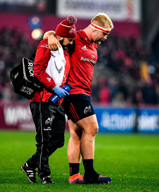 Loughman is assisted off the pitch with an injury. Photo by Brendan Moran/Sportsfile