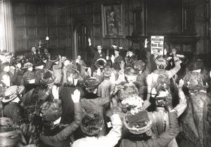 A Protestant Truth Society's women's meeting in Carton Hall, to protest against Home Rule for Ireland. A show of hands as approval of a petition to the King (Photo by Topical Press Agency/Getty Images)