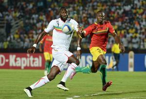 Mali forward Mustapha Yatabare looks to control the ball ahead of Guinea's Fode Camara during their African Cup of Nations clash in Mongomo. Photo: KHALED DESOUKI/AFP/Getty Images