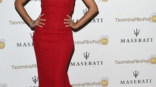 Eva wears a red Pamella Roland dress at the Taormina Film Festival in Sicily
