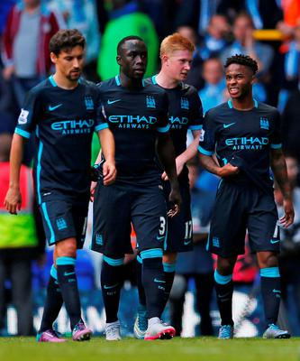 Manchester City's Jesus Navas, Bacary Sagna, Kevin De Bruyne and Raheem Sterling walk off dejected after the game