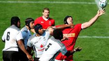 Canada's lock Jamie Cudmore (R) reaches for the ball during the international rugby union friendly match between Canada and Fiji, ahead of the 2015 Rugby World Cup on Saturday