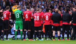 Manchester United manager Sir Alex Ferguson is given a 'guard of honour' prior his 1,500th and final match in charge of the club