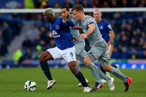 Arouna Kone of Everton breaks through Jonas Gutierrez and Ryan Taylor of Newcastle United