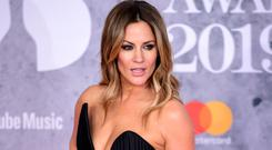 Caroline Flack defends new surgery show against criticism from Jameela Jamil (Ian West/PA)
