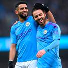 Bernardo Silva (right) celebrates with Riyad Mahrez after scoring Manchester City's second goal. Photo by Laurence Griffiths/Getty Images