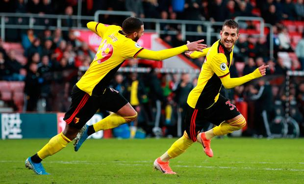 Watford's Roberto Pereyra (right) celebrates scoring his side's third goal of the game during the 3-0 win away to Bournemouth. Adam Davy/PA Wire.