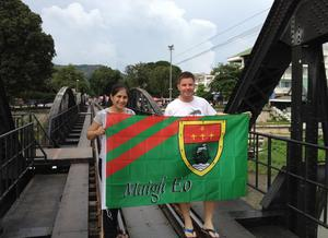 Co Down man Sean flying the Mayo flag in Thailand on the bridge over the river Kwai.