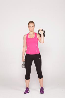 Alternating clean:  2/ Lower this kettlebell back to the start position, repeating the exact same movement on the opposite side. Continue this exercise alternating throughout.