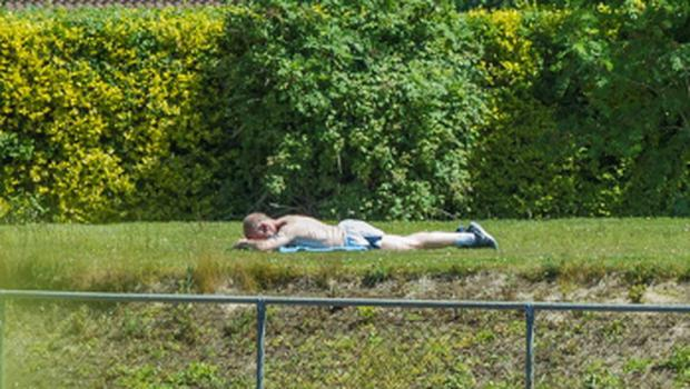 Michael Murray sunbathing in the grounds of UCD.