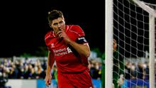 Steven Gerrard of Liverpool celebrates after scoring the opening goal with a header