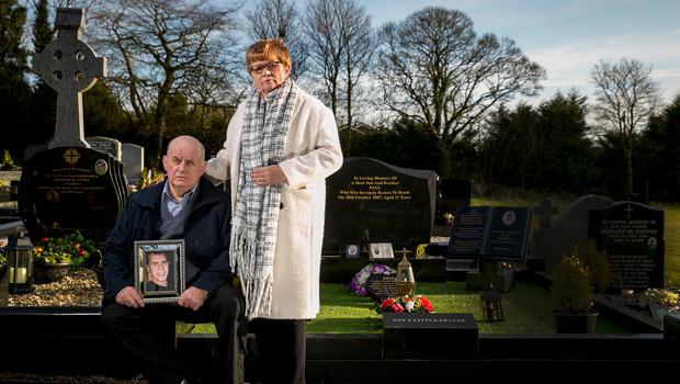 VIGIL: Stephen and Breege Quinn at the graveside of their murdered son Paul Quinn at St Patrick's Church in Cullyhanna, Co Armagh. Photo: Liam McBurney/PA