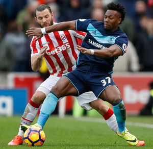 Middlesbrough's Adama Traore tussles with Stoke City's Erik Pieters. Photo: Reuters