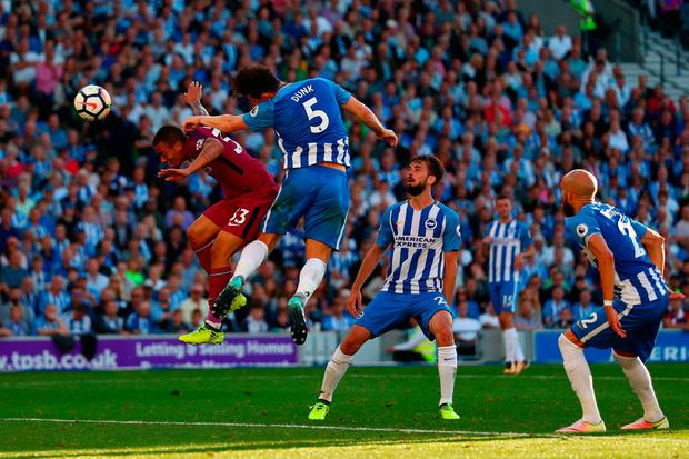 Gabriel Jesus of Manchester City beats Lewis Dunk of Brighton & Hove Albion to the ball to scores his sides second goal Photo: Getty