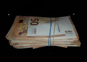 The Criminal Assets Bureau seized a total of €13,200               in cash, froze €35,921 in a bank account and seized a BMW               and a Ford vehicle along with records in relation to a               number of significant property transactions.