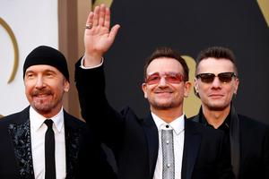 The Edge, Bono and Larry Mullen Jr. of U2 arrive at the 86th Academy Awards in Hollywood, California March 2, 2014.  REUTERS/Lucas Jackson