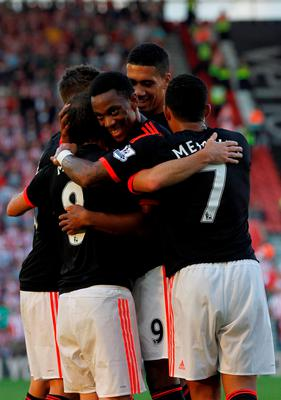 Manchester United's French striker Anthony Martial (C) and teammates congratulate Juan Mata