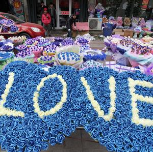 Bouquets of roses are displayed for sale at a flower shop in Weifang, China.
