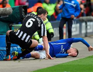 Newcastle's Mike Williamson leaves Jamie Vardy in a heap