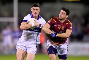 Diarmuid Connolly of St Vincent's holds off a challenge from Bernard Brogan,of St Oliver Plunketts Eogha Ruadh during the Dublin SFC final at Parnell Park. Photo: Stephen McCarthy / SPORTSFILE