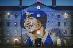 Hero: Feminist movement Herstory has told the history of many forgotten women, including pioneering aviator Lady Mary Heath, hailed here in an image projected here onto Collins Barracks. Photo: Arthur Carron